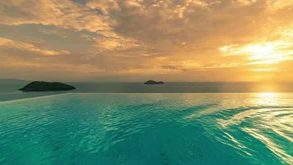 Cover Image for Sunset on the Infinity Pool View Background Sea in Koh Phangan Thailand