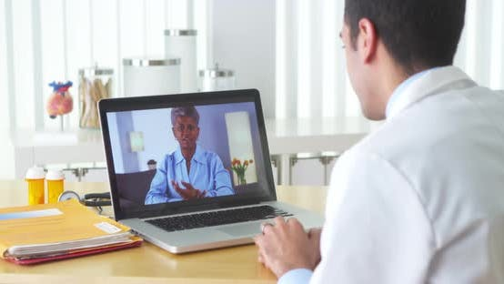 African patient video chatting with elderly patient