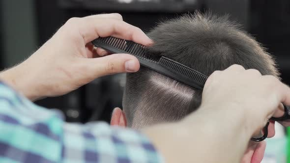Thumbnail for Cropped Shot of a Professional Barber Cutting Hair of a Man