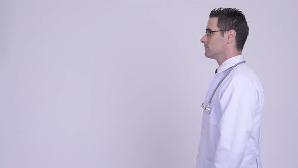 Cover Image for Profile View of Handsome Man Doctor Thinking