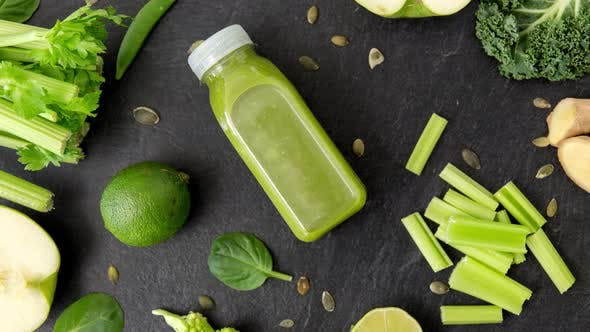 Thumbnail for Close Up of Bottle with Green Juice and Vegetables