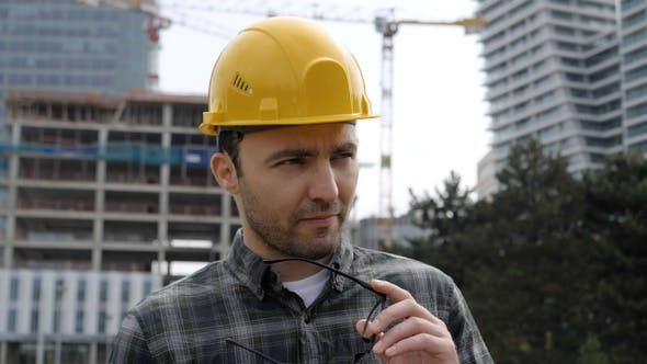 Thumbnail for Construction Worker Thinking Standing in Front of The Construction