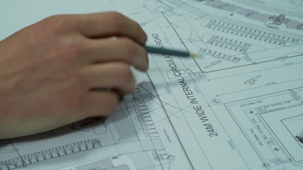 Thumbnail for Engineers Planning Road Construction Around Buildings
