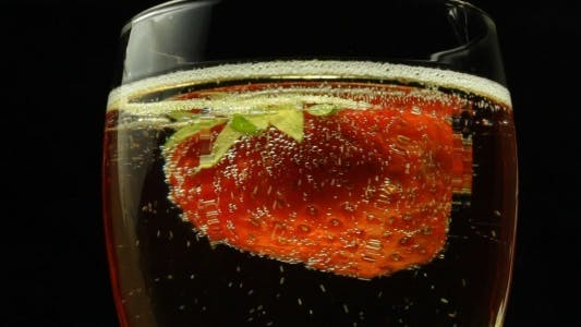 Thumbnail for Strawberry In Glass Of Sparkling Wine