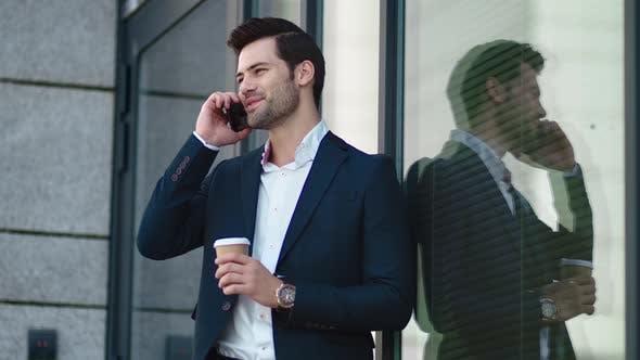 Thumbnail for Closeup Businessman Smiling Outdoors. Businessman Drinking Take Away Coffee