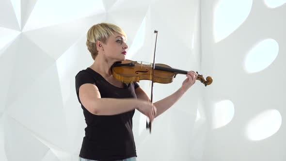 Thumbnail for Violinist Performs a Musical Composition on a Violin in a Studio