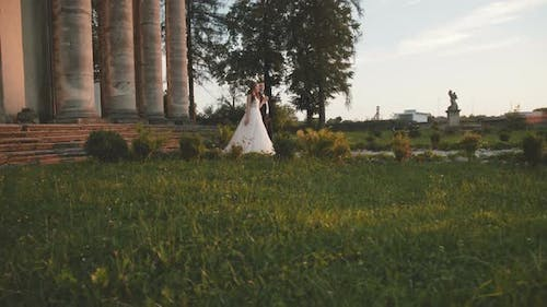 Defile of Lovely Wedding Couple on Track at Ancient Beautiful Castle