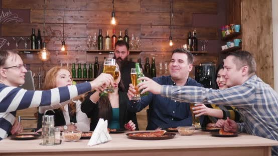 Thumbnail for Happy Positive Friends Clinking Their Glasses with Beer