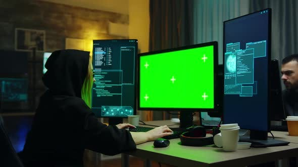 Thumbnail for Hacker Girl Wearing a Black Hoodie in Front of Computer