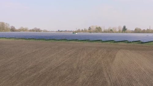 A Solar Farm and Traditional Farming Side By Side