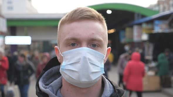 Thumbnail for Guy Wearing Protective Mask From Virus Outdoor in the People Crowdy. Portrait of Young Man with