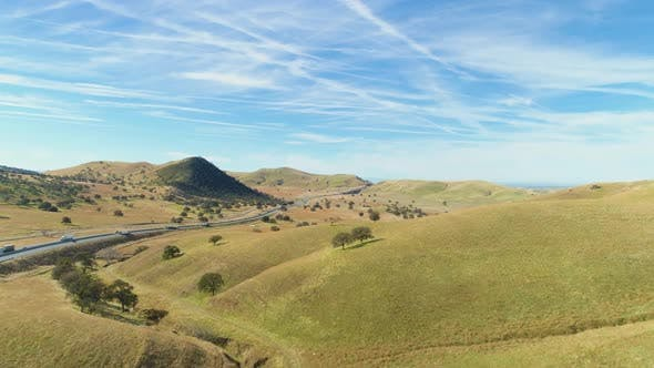Thumbnail for Highway 51 and Hilly Green Farmland. Kern County. California, USA. Aerial View