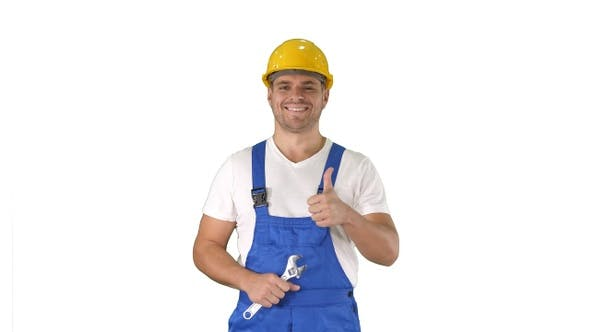 Thumbnail for Worker with wrench showing thumb up and smiling to camera