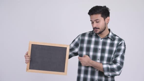Thumbnail for Young Happy Bearded Indian Man with Blackboard and Giving Thumbs Up