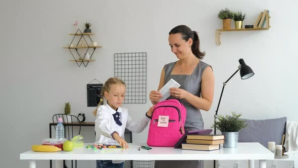 Mother Helping Daughter to Prepare for School