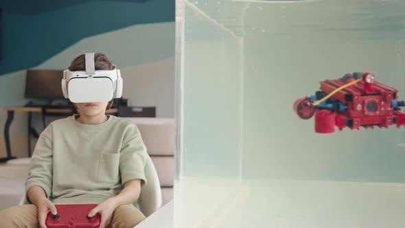 Schoolboy Wearing VR Glasses Controlling Robo Boat