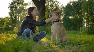 Tender Relationship Between the Girl Mistress and Her Dog.