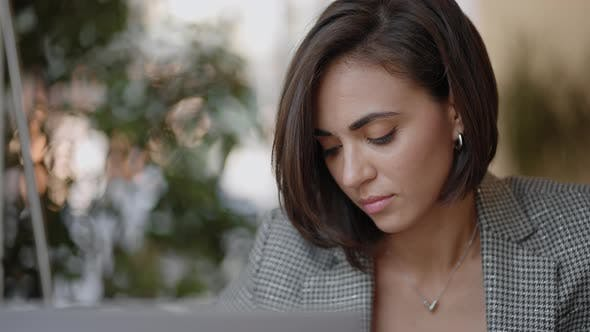 Portrait of Ambitious Muslim Business Woman Working with Laptop Indoors at Home Concentrated on