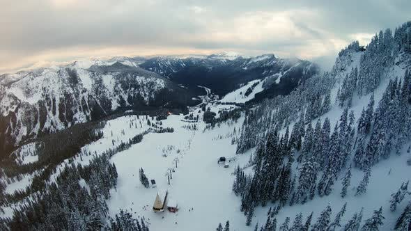Cover Image for Aerial Pan Up Winter Recreational Sports Destination Mountain Resort
