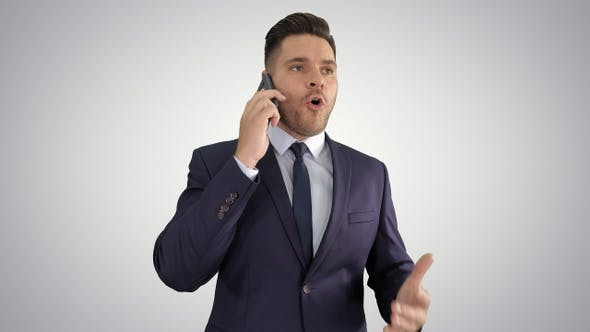 Thumbnail for Serious Worried Businessman Talking on Cellphone on Gradient