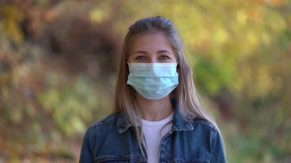 Thumbnail for Portrait of Woman Wearing a Face Mask Against the Second Wave Quarantine Coronavirus COVID-19