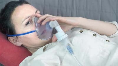 Woman with Inhalation Mask