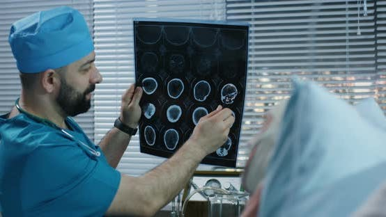 Thumbnail for Doctor Showing Brain Scan Image To Patient