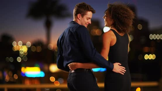 Thumbnail for Lovely couple on a date enjoying view of city.  Attractive young couple dancing outdoors in city. 4k