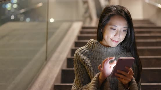 Thumbnail for Asian woman use of smart phone at night