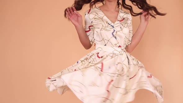 Thumbnail for Girl in While Light Dress and Twirling Around in Studio