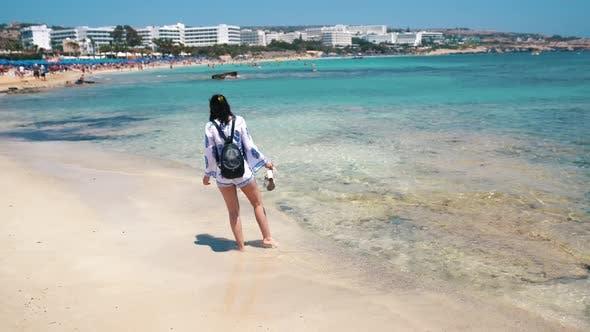 Thumbnail for Beautiful Scene Of A Woman Walking On Ocean Beach