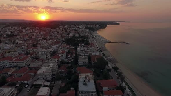 Thumbnail for Aerial View of Small Resort Town at Sunrise. Nea Kallikratia, Greece
