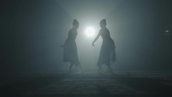 Thumbnail for The Silhouettes of Two Slim Professional Ballerinas Dancing Simultaneously in Black Dress in the