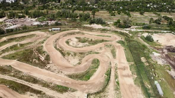 Motocross dirt circuit race track, aerial drone view.