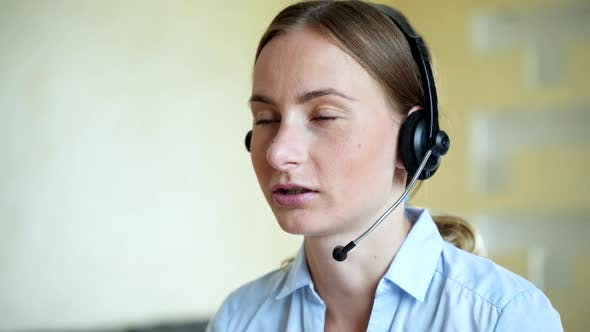 Thumbnail for Businesswoman Talking on the Phone While Working on Her Computer at the Office. Call Сenter Agent