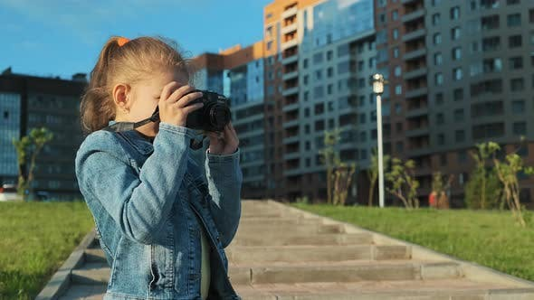 Thumbnail for Portrait of a Little Girl Holding a Camera
