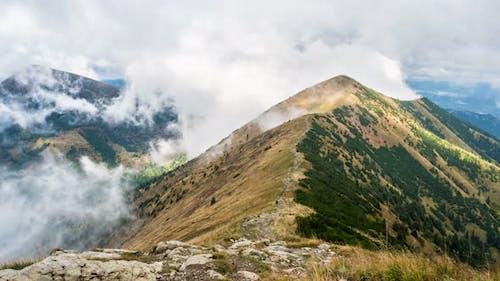 Mystic Mountain Hidden in Dramatic Clouds in Alpine Nature Landscape