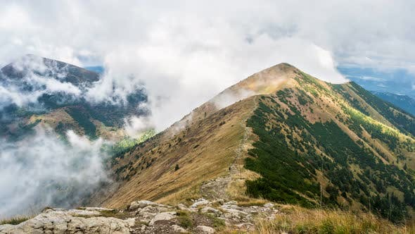 Thumbnail for Mystic Mountain Hidden in Dramatic Clouds in Alpine Nature Landscape