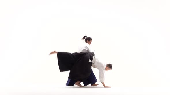 Thumbnail for Man and Woman in White Keikogi Showing Aikido Techniques, Isolated on White. Slow Motion.