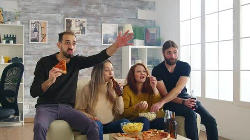Group of Friends Celebrating Victory of Football Match
