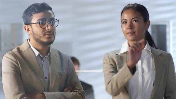 Cover Image for Multiethnic Coworkers Using Invisible AR Screen and Talking in Office