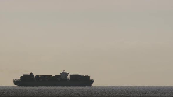 Thumbnail for A Cargo Ship at Dawn