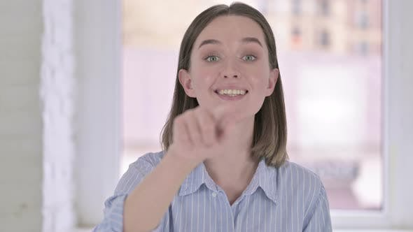 Thumbnail for Portrait of Attractive Young Woman Pointing Finger and Inviting