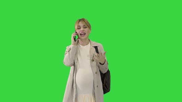 Thumbnail for Beautiful Pregnant Woman Talking on the Phone As She Walks on a Green Screen, Chroma Key