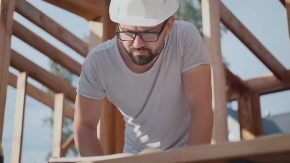 Designer or Foreman at a Construction Site. Build a House with Draws