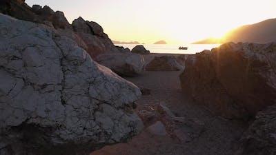 Rocky Island Beach with Boat on the Horizon
