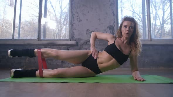 Thumbnail for Sporty Woman Working Out Outer Thigh on Mat in Gym