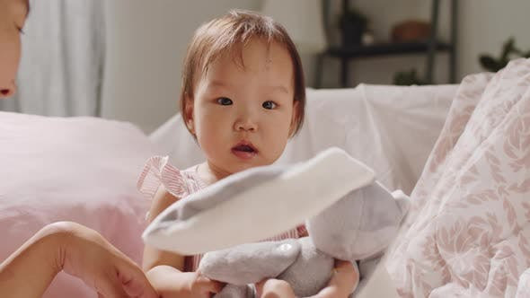 Thumbnail for Asian Mother Playing with Cute Toddler Daughter at Home