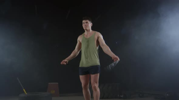 Thumbnail for Man Using Skipping Rope for Workout