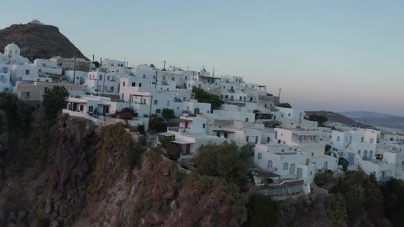 Thumbnail for Aerial Perspective Over Typically Greek Village Small Town on Island in Sunset Golden Hour Light